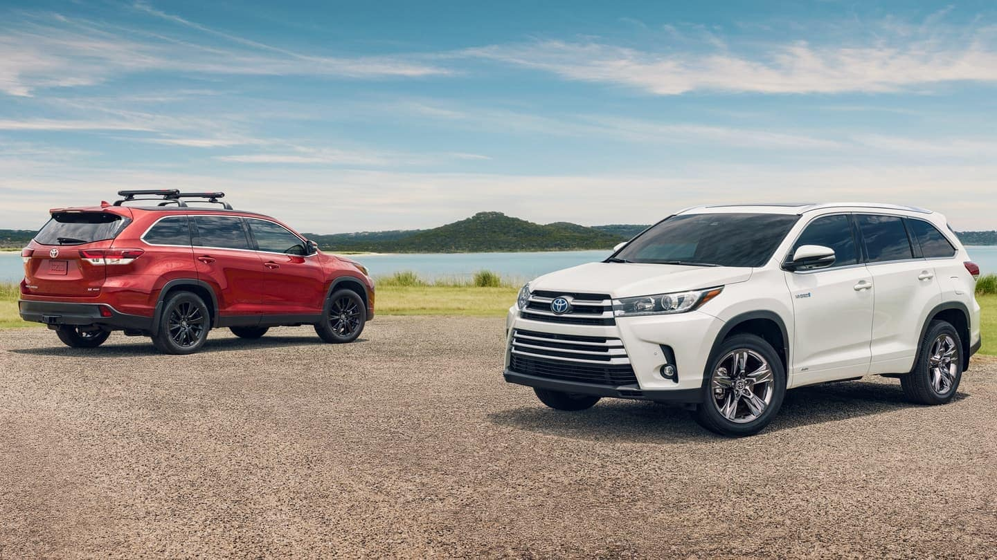 2019 Toyota Highlander suvs in red and white front and back view
