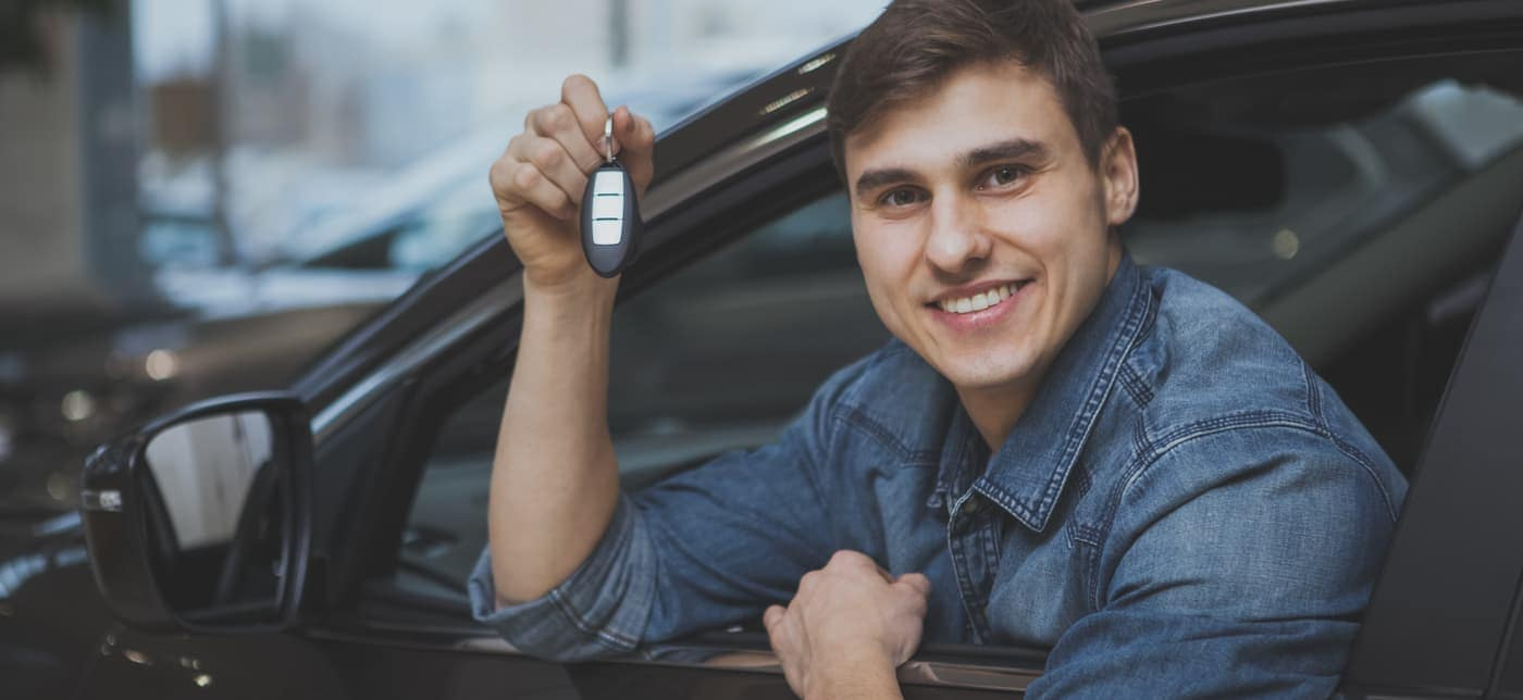 young man buying car