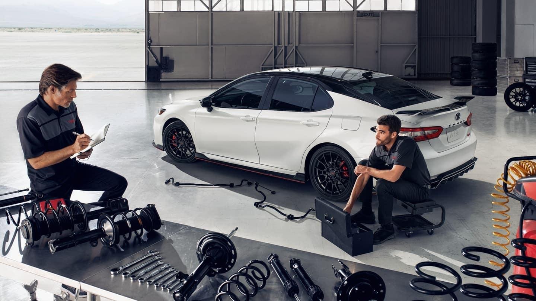 2020 Toyota Camry mechanics working on car