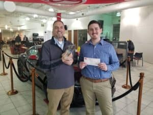 Pictured are John Moore, Used Car Manager at Andrew Toyota as well as Billy Zakrzewski of the Wisconsin Humane Society.