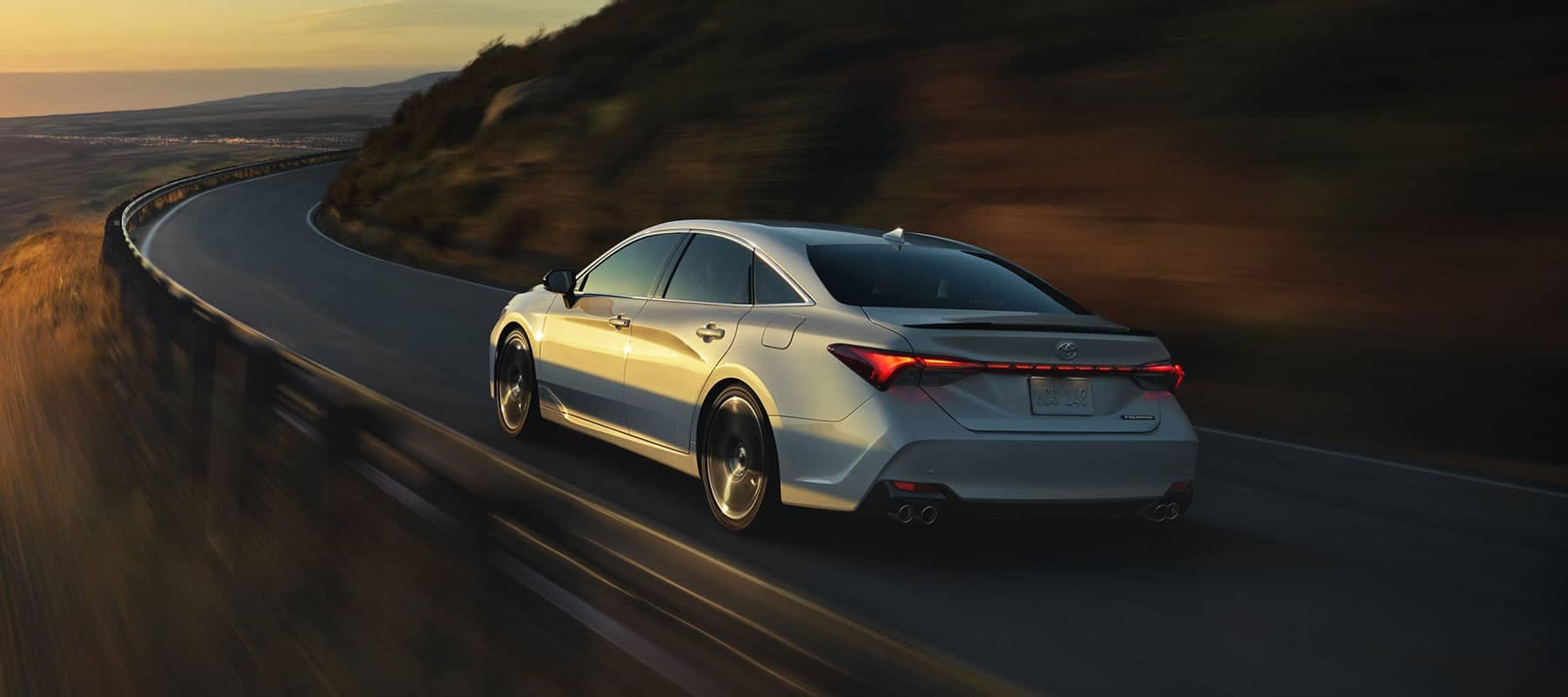 Toyota Avalon driving on road