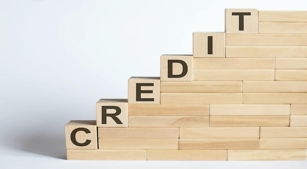 Credit is spelled out on a set of ascending wooden blocks.