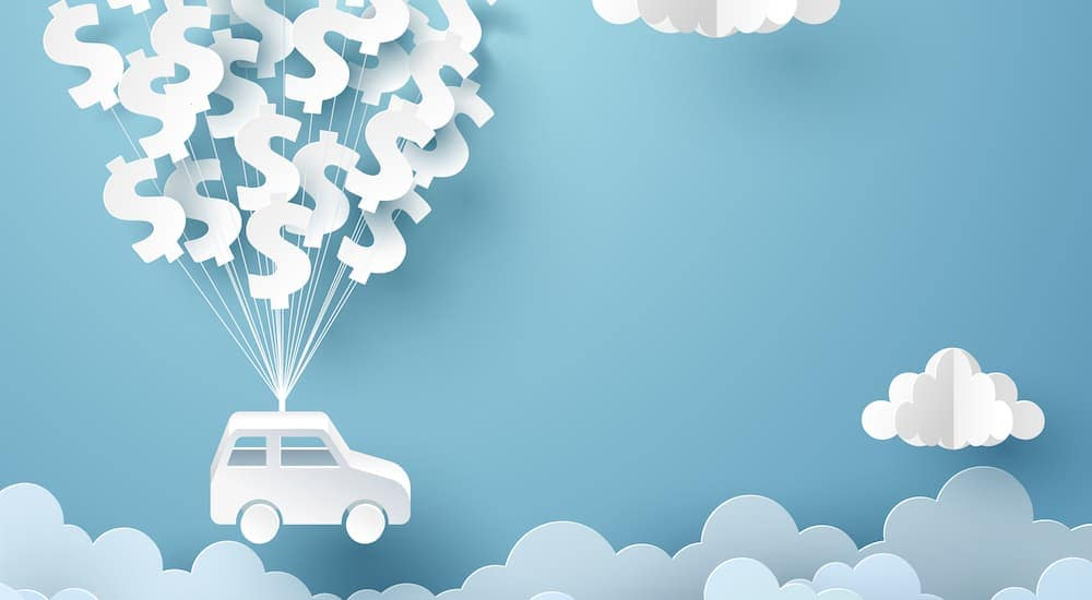 A car is floating through the sky with dollar signs carrying it.