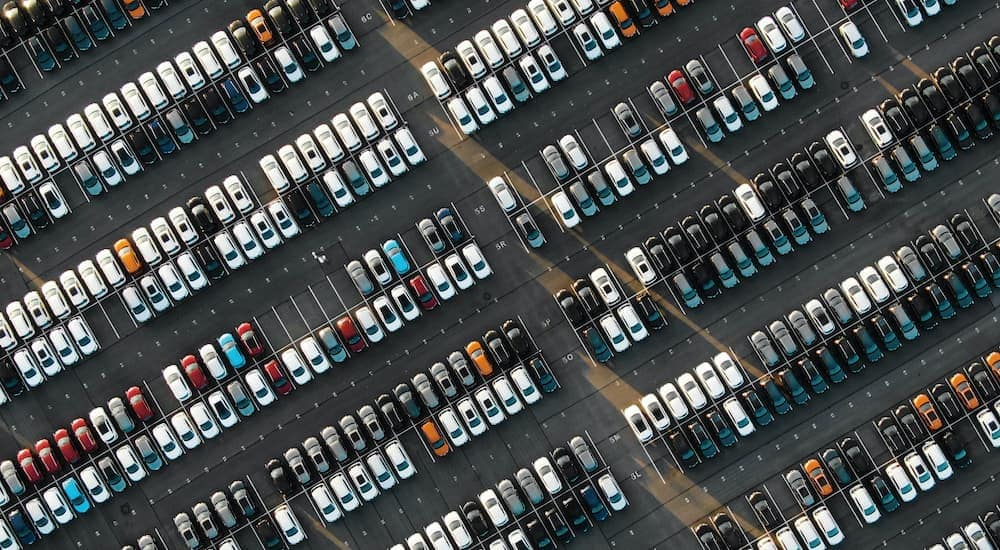 An aerial view of a parking lot full of cars at a bad credit car lot in Kansas City.