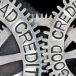A close up of gears is shown one says good credit and another days bad credit.