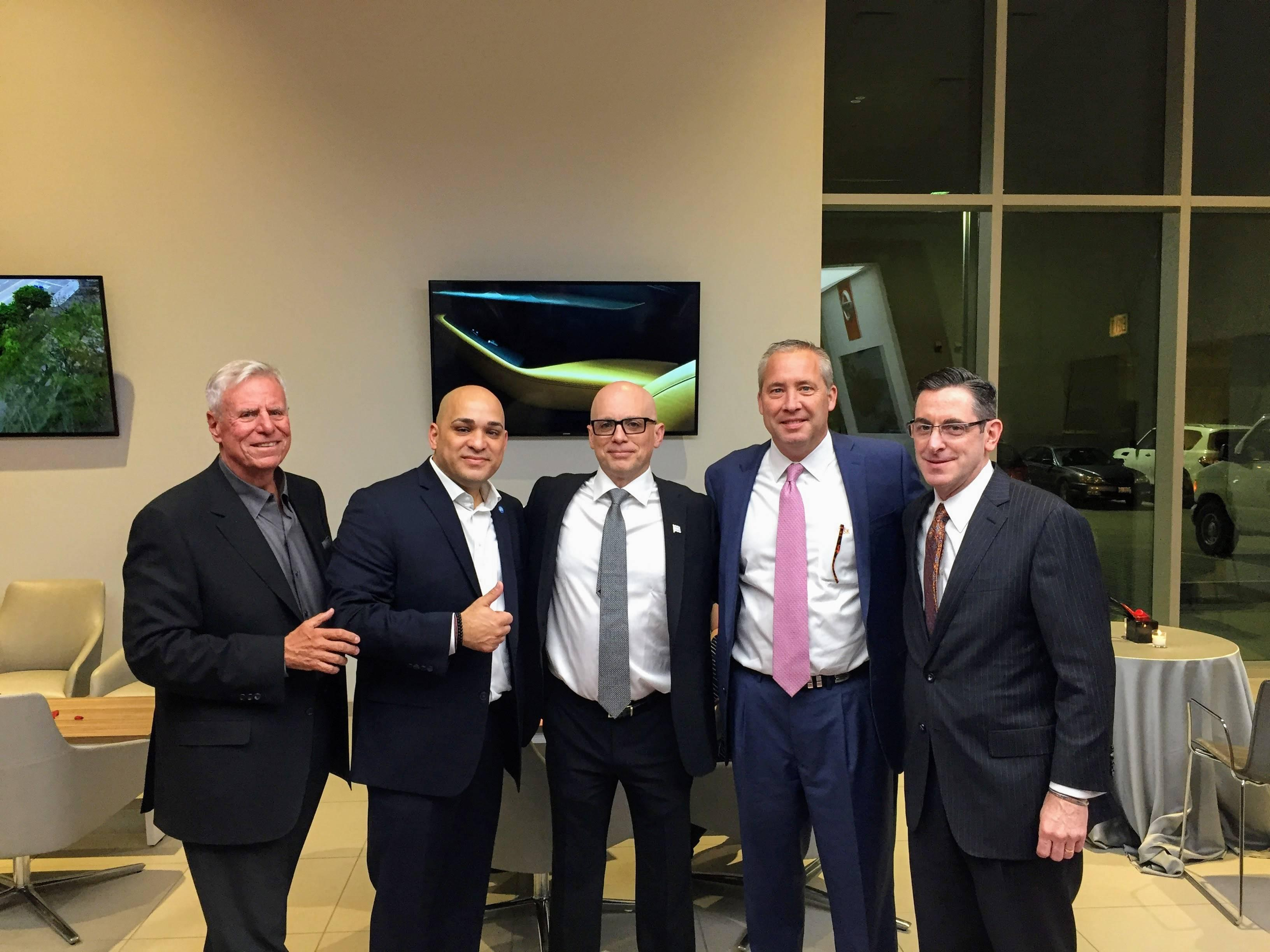 Michael Berman with Commissioner Luis Arroyo Jr, VP George Katsikas, and Nissan Execs;