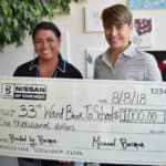 Berman Auto Group's Leah Garcia presenting donation check to Alderman Deb Mell