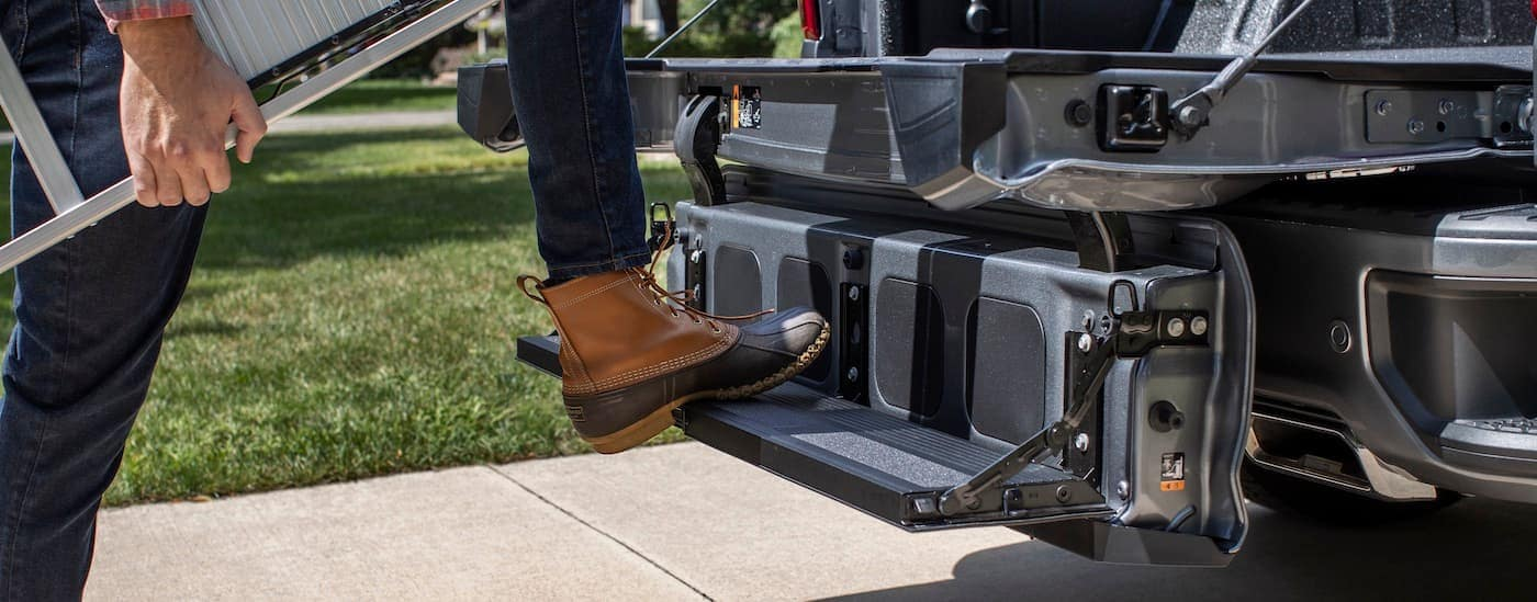 A close up is shown of the Multi-Flex Tailgate on a dark grey 2021 Chevy Silverado.