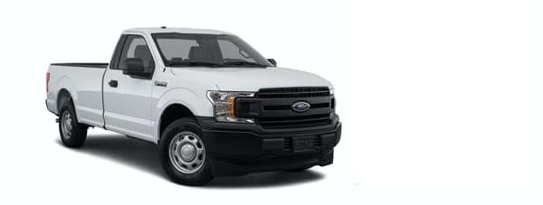 A white Ford F-150 is angled right.