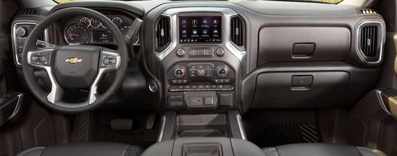 The dashboard and infotainment features on a 2020 Chevy Silverado 1500 are shown.