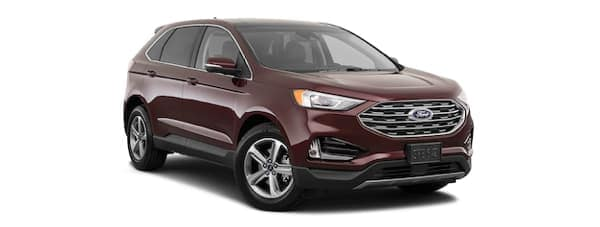 A burgundy 2019 Ford Edge is facing right.