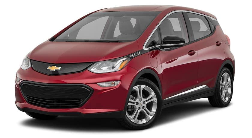 A red 2020 Chevy Bolt is facing left.