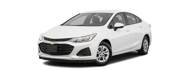 A white 2019 Chevy Cruze is facing left.