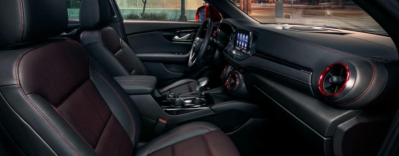 The black interior with red details is shown in a 2020 Chevy Blazer.