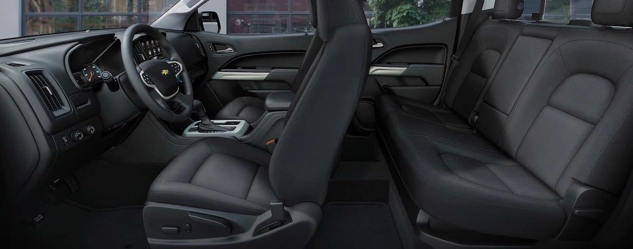 A cross section is shown of the two rows of seats in a 2020 Chevy Colorado Crew Cab.