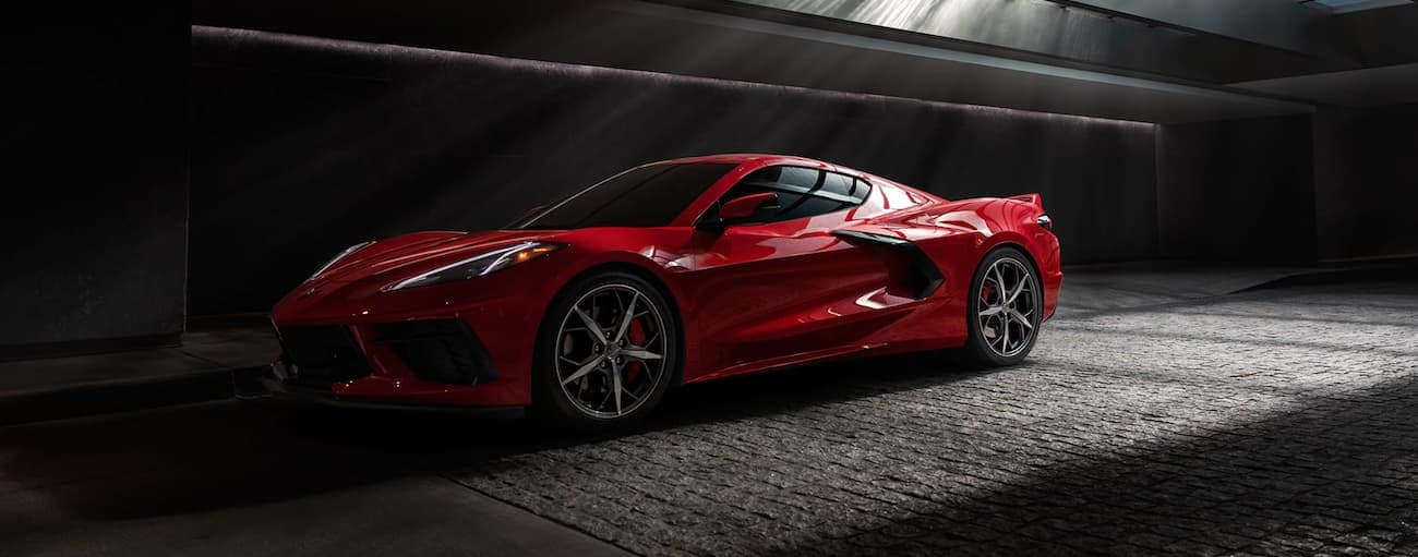 A red 2020 Chevy Corvette is in a dark tunnel near Indianapolis, IN.