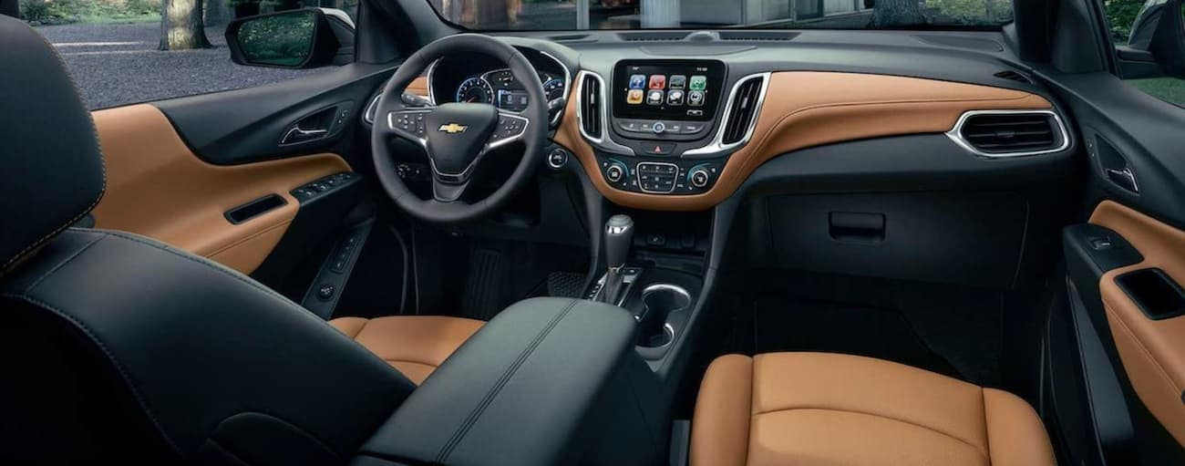 The black and tan interior of a 2020 Chevy Equinox is shown.