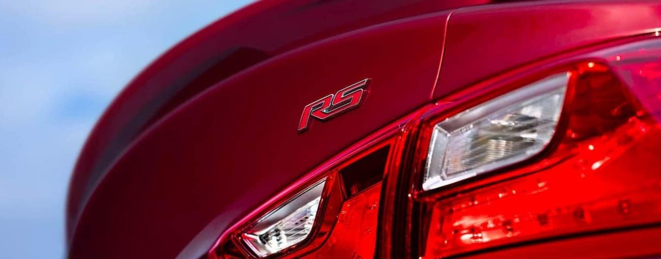 The rear badging on a red 2020 Chevy Malibu RS is shown.