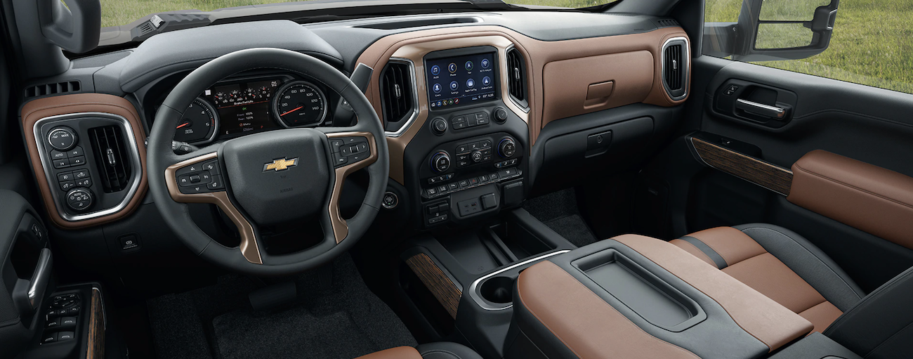 The black and brown interior of a 2020 Chevy Silverado 2500 is shown.