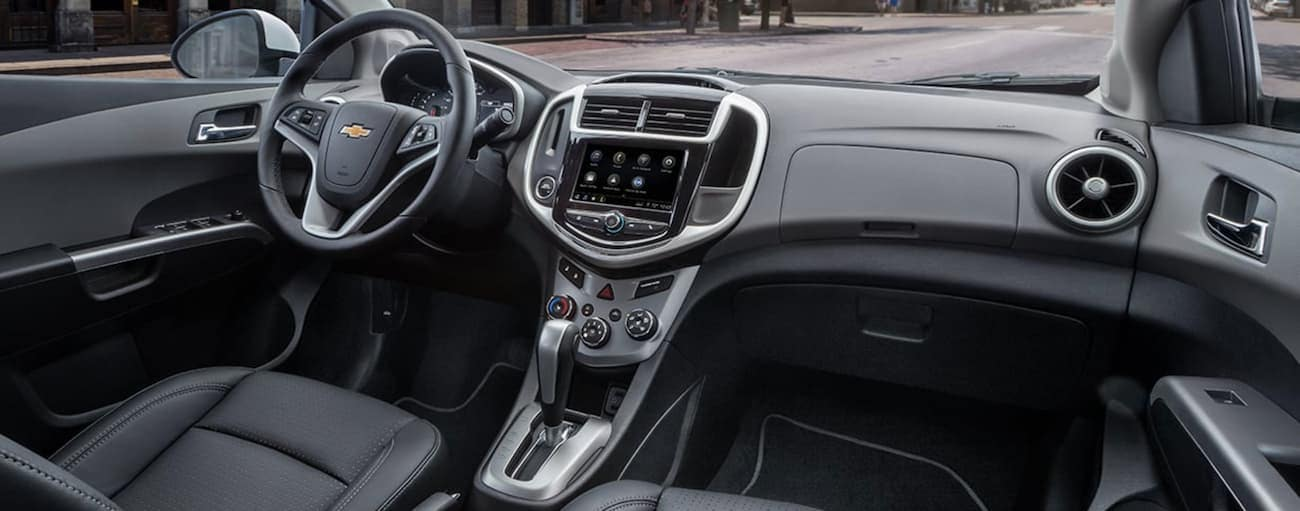 The black interior of a 2020 Chevy Sonic is shown.