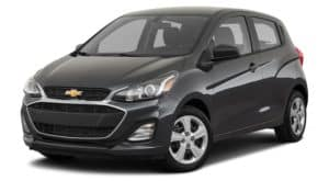 A black 2020 Chevy Spark is facing left.