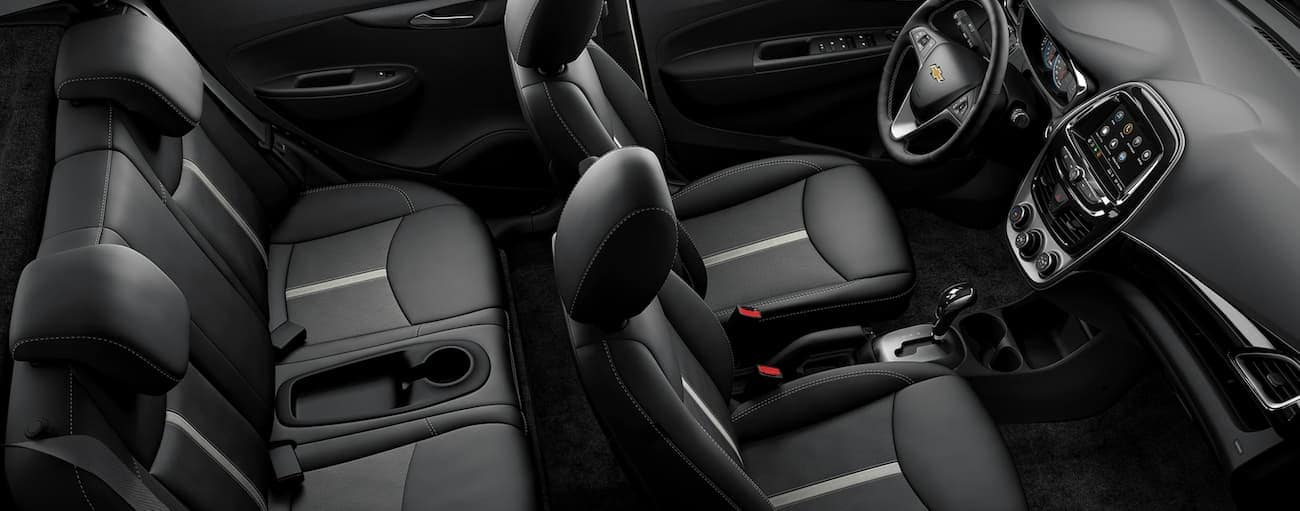 The black interior of a 2020 Chevy Spark is shown from an above angle.