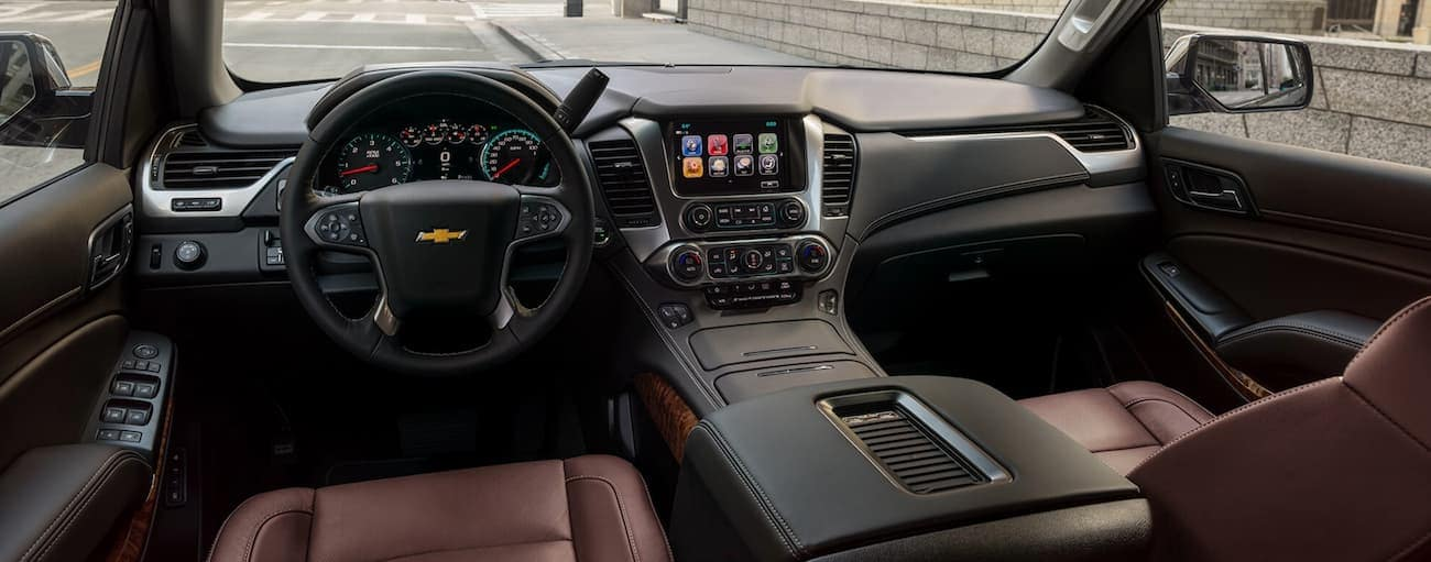 The dashboard and infotainment features are shown in a 2020 Chevy Suburban.