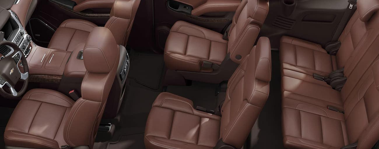 A view from above is shown of the brown interior in a 2020 Chevy Tahoe.
