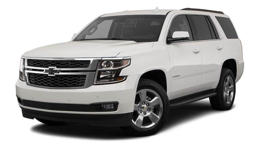 A white 2020 Chevy Tahoe is facing left.