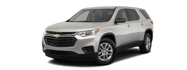 A silver 2020 Chevy Traverse is facing left.