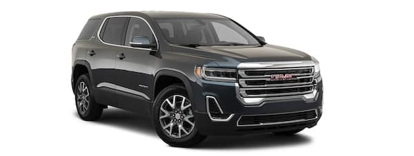 A black 2020 GMC Acadia is facing right.