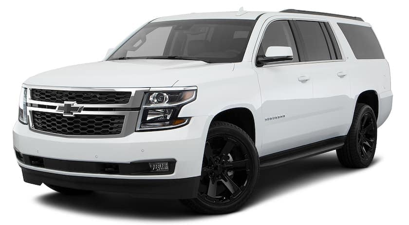 A white 2018 Chevrolet Suburban is angled left on a white background.