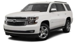 A white 2019 used Chevrolet Tahoe is angled left on a white background.
