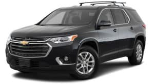 A black 2018 used Chevrolet Traverse is angled left on a white background.