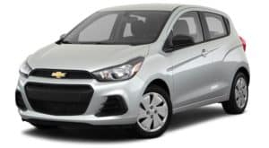 A silver 2018 used Chevy Spark is facing left.