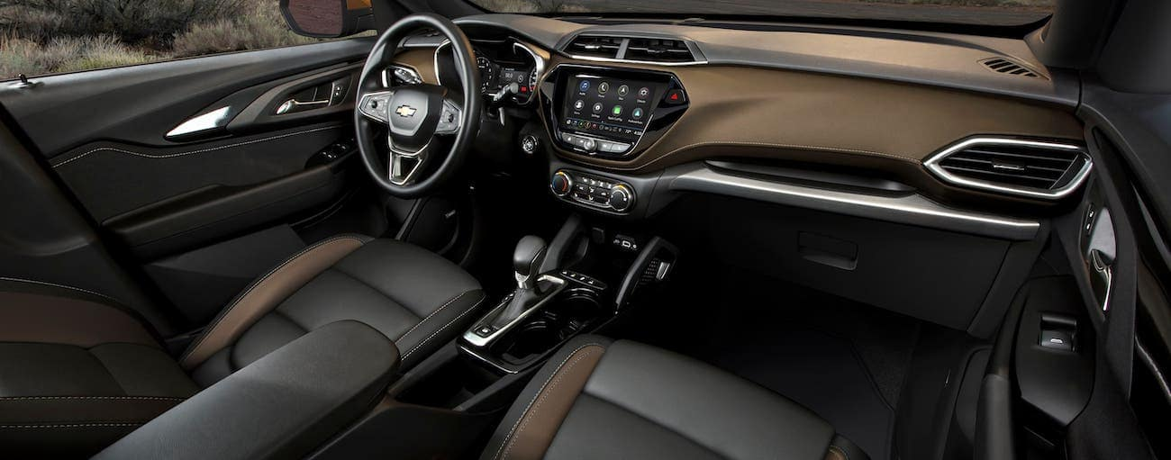 The black and brown interior and dashboard are shown in a 2021 Chevy Trailblazer in Indianapolis.