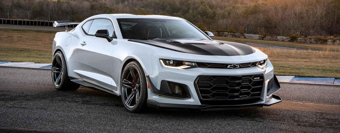 A white 2020 Chevy Camaro ZL1 is parked on a race track near Indianapolis, IN.