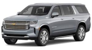 A silver 2021 Chevy Suburban is angled left.