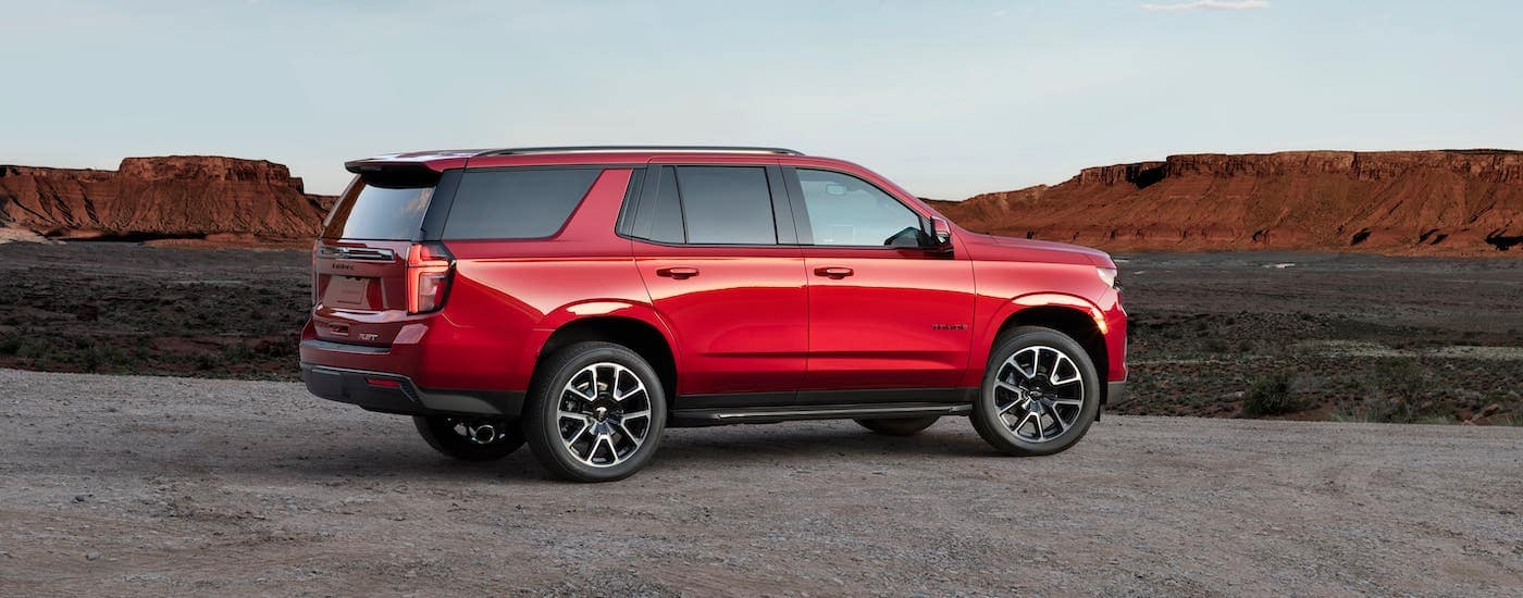 A red 2021 Chevy Tahoe RS is overlooking a canyon.