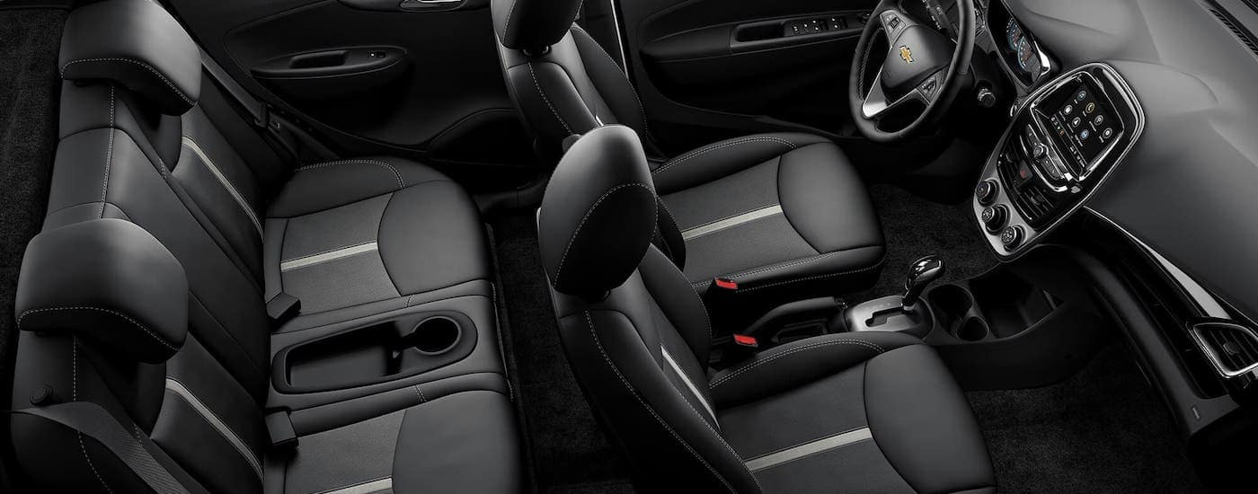 The two rows of black seats in a 2021 Chevy Spark are shown from above.
