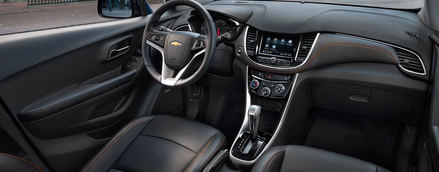 The black front seats with orange stitching are shown in a 2021 Chevy Trax.