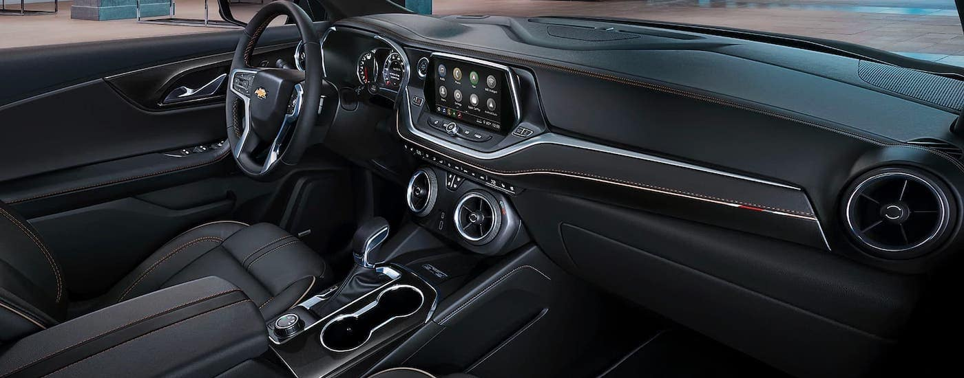 The black interior with orange accent inside a 2021 Chevy Blazer is shown.