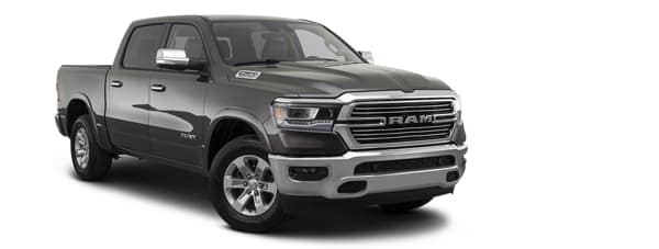 A grey 2021 Ram 1500 is angled right.