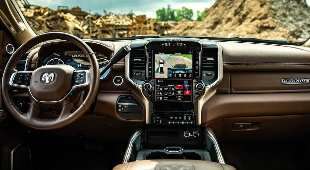 The brown and black interior is shown on a 2020 Ram 3500 Laramie.
