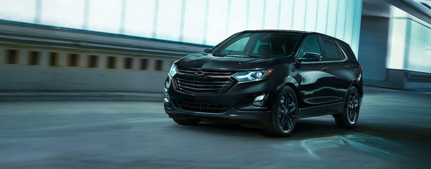 A black 2021 Chevy Equinox is driving through a tunnel.