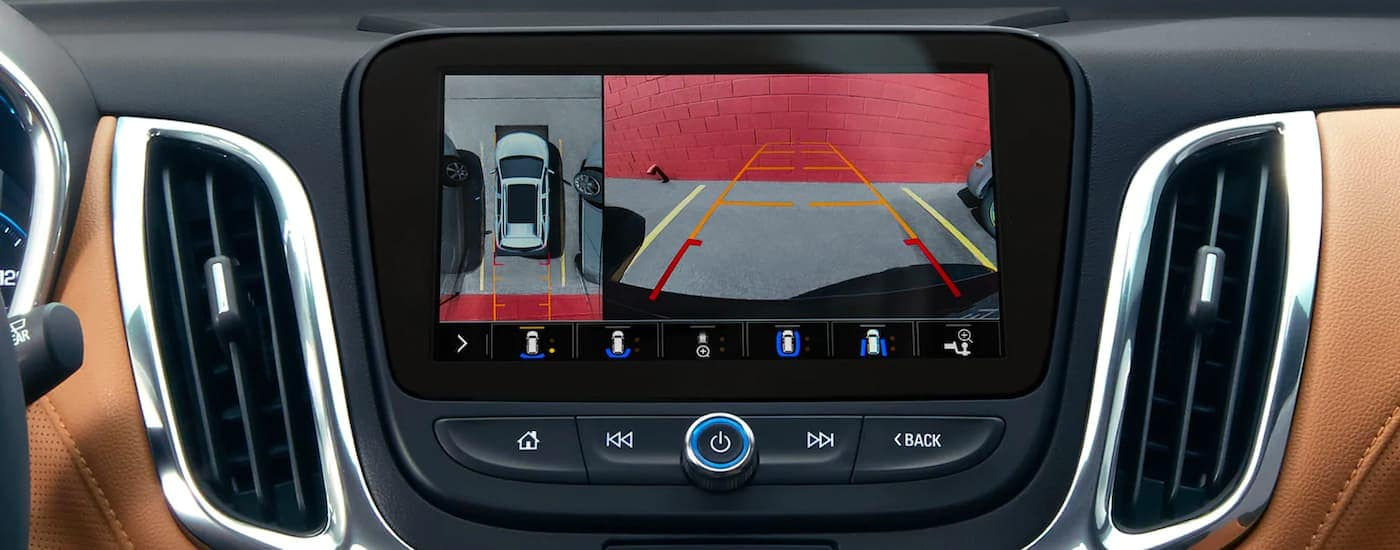 A close up shows the infotainment screen with the back up camera on a 2021 Chevy Equinox.