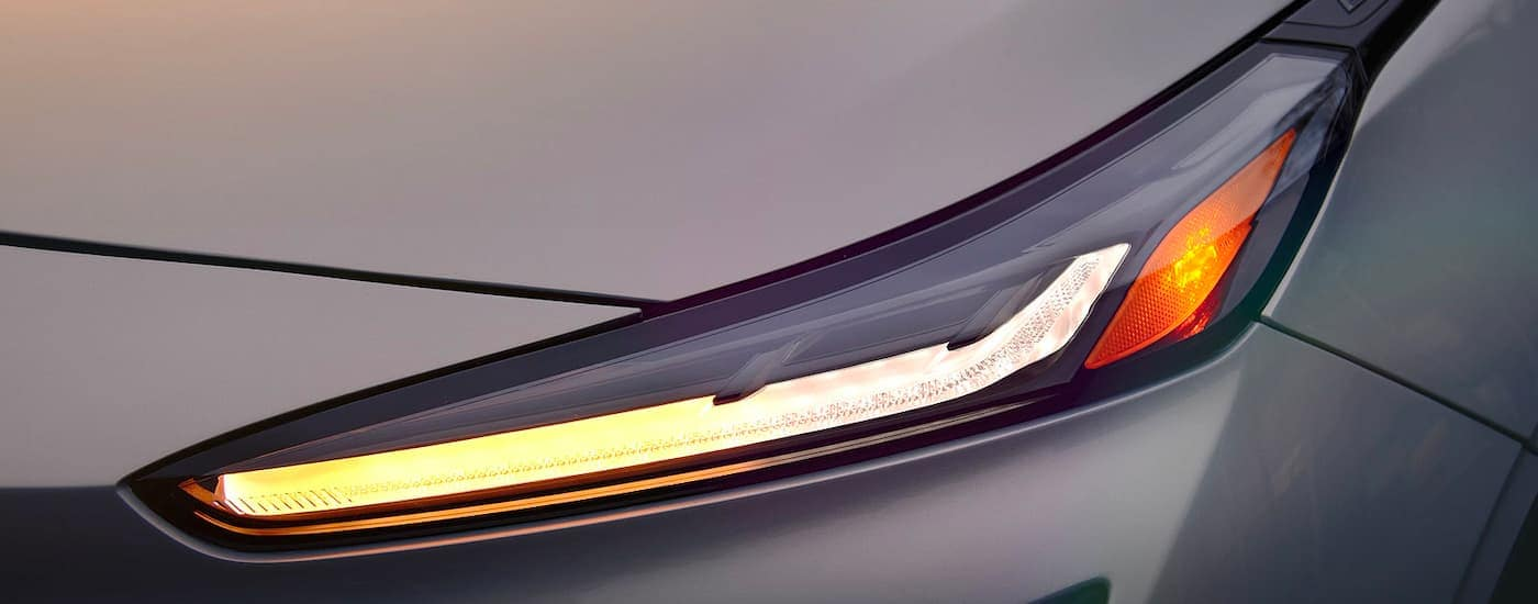 A close up shows the driver side headlight on a 2022 Chevy Bolt EUV, the newest addition to the line-up of Chevy EVs.