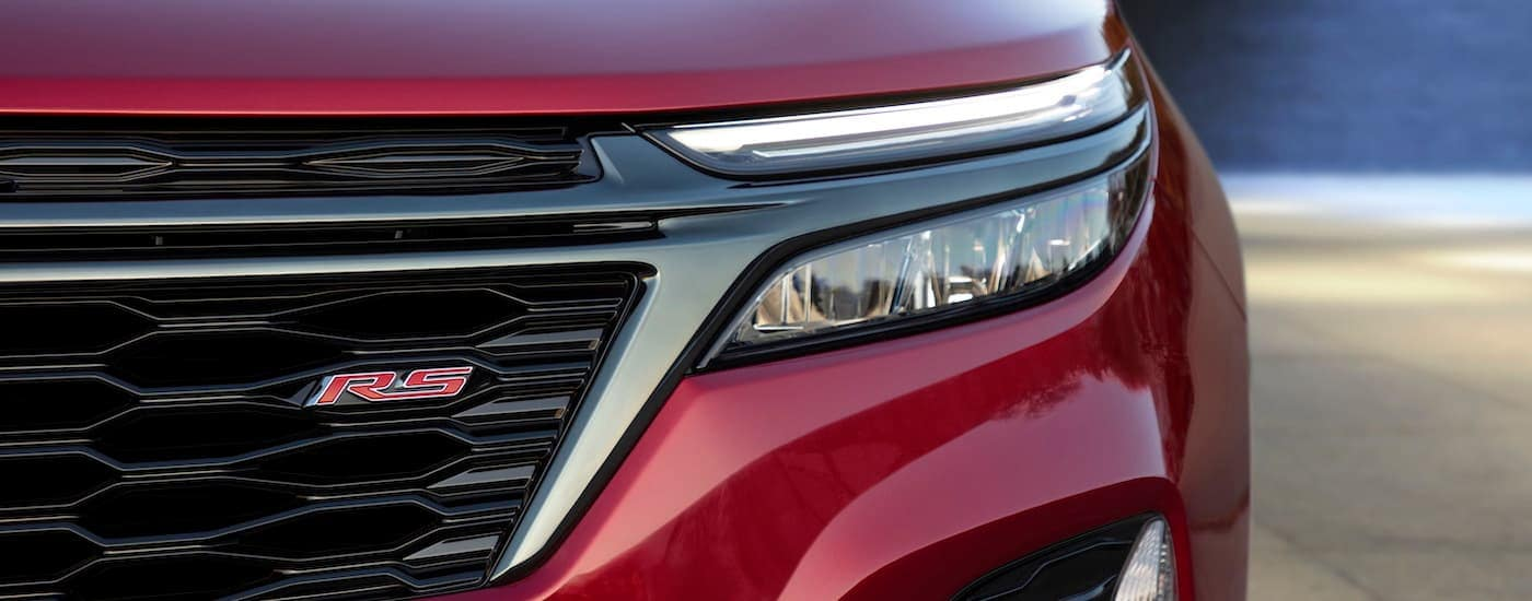 A close up shows the grille and headlight on a 2022 Chevy Equinox RS.