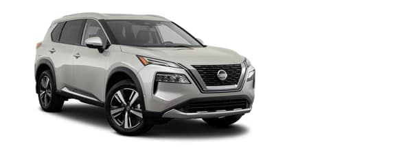 A white 2021 Nissan Rogue is angled right.