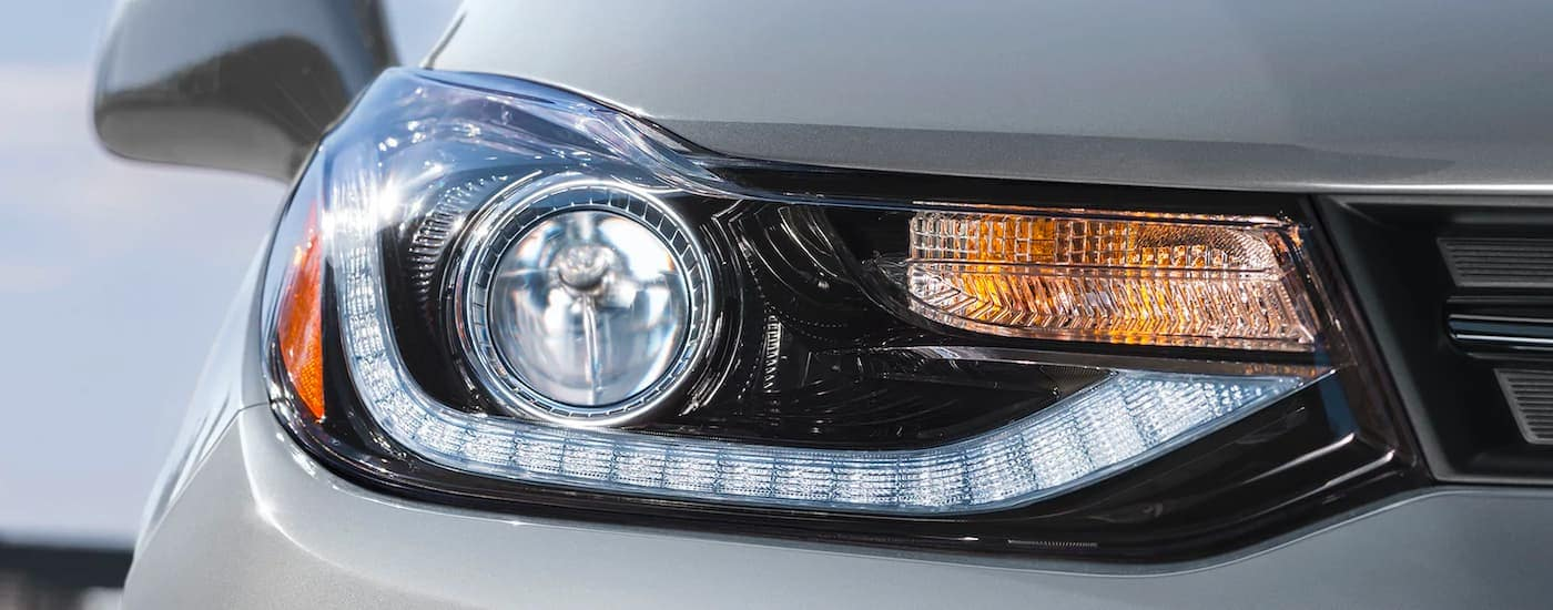 A close up shows the passenger headlight of a 2021 Chevy Trax.